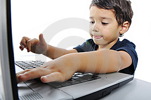 Male child in front of computer