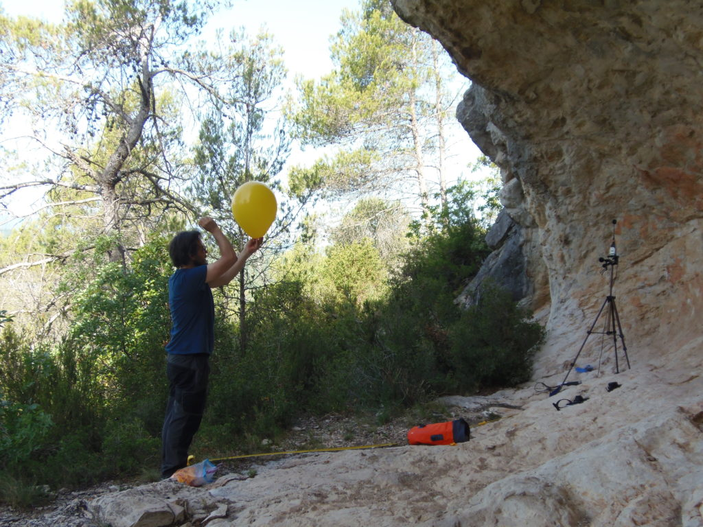 Tommaso Mattioli doing acoustic measurements at the rock art site of Abri A des Eissartenes (Le Val, France).
