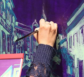 Pintant a l'oleo