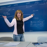 Photograph of a lecturer at the board